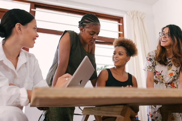 Business women collaborate using project management tools