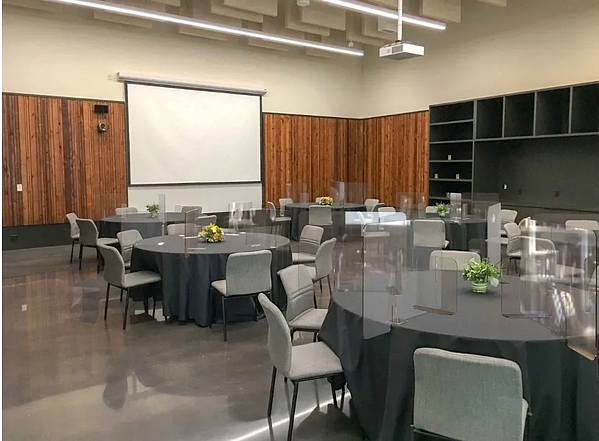 event meeting space with attendee shields on tables