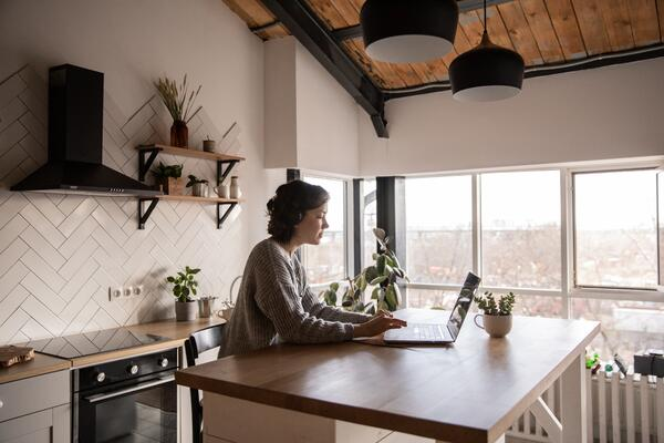 Remote employee works on laptop at home