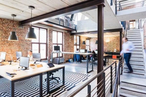 Employees work in a modern design office
