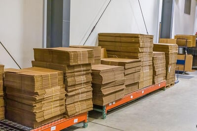 sustainable packing materials in pc/nametag production facility