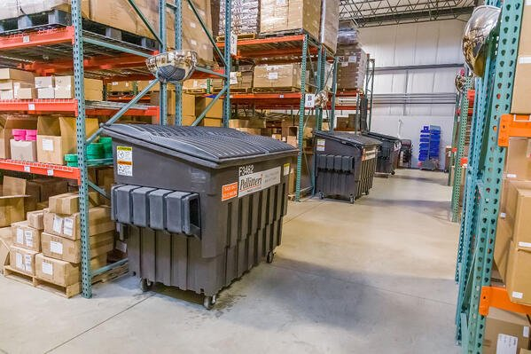 industrial recycling bins in pc/nametag's production facility