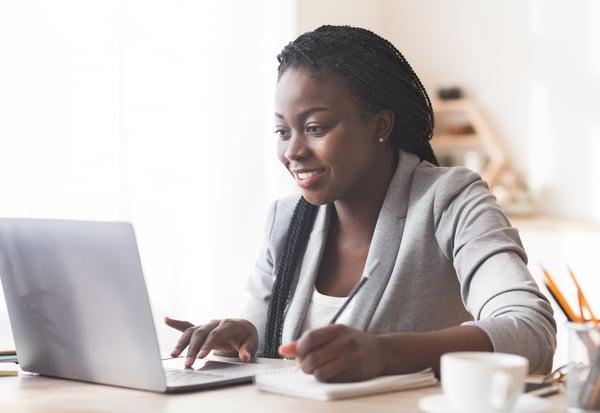 Woman takes professional development course online