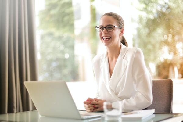 happy remote employee engaged at her work laptop