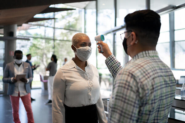 event attendee gets forehead temperature scan