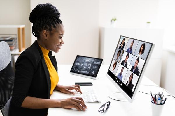 A woman enjoys a virtual conference