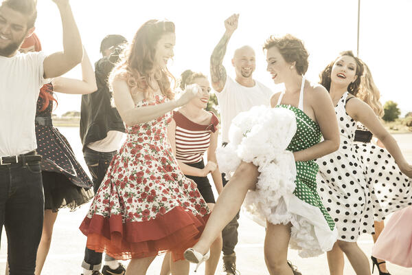 adults dance at a 1950s style dance party