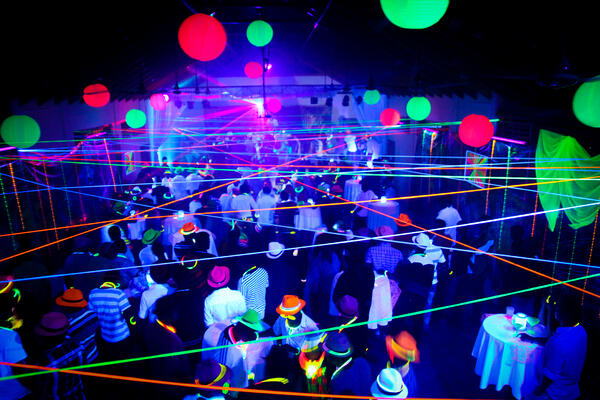 guests attend a neon party with glow in the dark costumes
