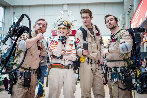 convention cosplayers dress up as ghostbusters characters