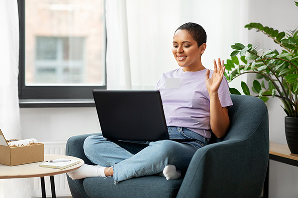 excited woman attends a virtual event session