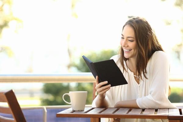 Woman reads a professional development book